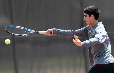 Kyle Grillot - kgrillot@shawmedia.com   Prairie Ridge's Bij Heydari hits a return during the Fox Valley Conference tennis match Saturday at Crystal Lake Central.