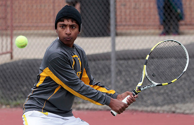 Kyle Grillot - kgrillot@shawmedia.com   Jacobs Kailash Panchapakesan hits a return during the Fox Valley Conference tennis match Saturday at Crystal Lake Central.