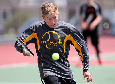 Kyle Grillot - kgrillot@shawmedia.com   Jacobs sBrandon Sidor hits a return during the Fox Valley Conference tennis match Saturday at Crystal Lake Central.