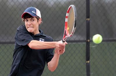 Kyle Grillot - kgrillot@shawmedia.com   Hampshire's Elisha Hougland hits a return during the Fox Valley Conference tennis match Saturday at Crystal Lake Central.