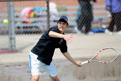 Kyle Grillot - kgrillot@shawmedia.com   Hampshire's Elisha Hougland hits a return during the Fox Valley Conference tennis match Saturday at Crystal Lake Central.