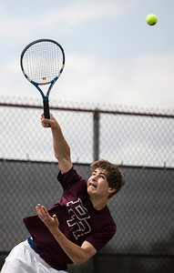 Kyle Grillot - kgrillot@shawmedia.com   Prairie Ridge's Brad Henning serves the ball during the Fox Valley Conference tennis match Saturday at Crystal Lake Central.