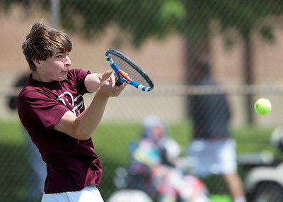 Kyle Grillot - kgrillot@shawmedia.com   Prairie Ridge's Brad Henning hits a return during the Fox Valley Conference tennis match Saturday at Crystal Lake Central.
