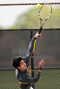 Kyle Grillot - kgrillot@shawmedia.com   Jacobs Kingsley Bernardo serves the ball during the Fox Valley Conference tennis match Saturday at Crystal Lake Central.