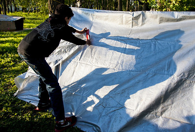 Kyle Grillot - kgrillot@shawmedia.com   Holland Sersan, 13, works to construct a shelter during the PADS Sleep Out for Shelter event at  Living Waters Church Saturday, May 11, 2013. The event is in it's fourth year, and it's the biggest fundraiser for PADS where participants are encouraged to sleep in shelters or tents.