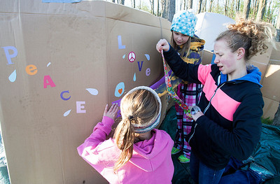 Kyle Grillot - kgrillot@shawmedia.com   Kelly Frake, 10, (top left) works with her sister Jordyn Frake, 13, (right) and Samantha Henstreet, 9, to construct a cardboard shelter during the PADS Sleep Out for Shelter event at  Living Waters Church Saturday, May 11, 2013. The event is in it's fourth year, and it's the biggest fundraiser for PADS where participants are encouraged to sleep in shelters or tents.