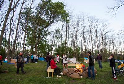 Kyle Grillot - kgrillot@shawmedia.com   Participants gather around a fire during the PADS Sleep Out for Shelter event at  Living Waters Church Saturday, May 11, 2013. The event is in it's fourth year, and it's the biggest fundraiser for PADS where participants are encouraged to sleep in shelters or tents.