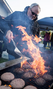 Kyle Grillot - kgrillot@shawmedia.com   Bob Huckins with the LAke in the Hills Rotary cooks hamburgers for participants during the PADS Sleep Out for Shelter event at  Living Waters Church Saturday, May 11, 2013. The event is in it's fourth year, and it's the biggest fundraiser for PADS where participants are encouraged to sleep in shelters or tents.