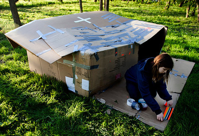 Kyle Grillot - kgrillot@shawmedia.com   Summer Goodwin, 10,  decorates her cardboard shelter during the PADS Sleep Out for Shelter event at  Living Waters Church Saturday, May 11, 2013. The event is in it's fourth year, and it's the biggest fundraiser for PADS where participants are encouraged to sleep in shelters or tents.