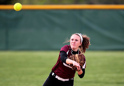 Kyle Grillot - kgrillot@shawmedia.com   Prairie Ridge junior Sammy Hempen throws out Cary-Grovejunior Jamie Deering during the girls softball game at Prairie Ridge high school Monday, May 12, 2013.