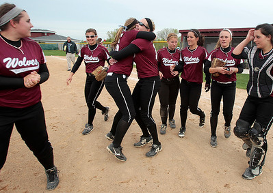 Kyle Grillot - kgrillot@shawmedia.com   The Prairie Ridge celebrates with her team after winning the girls softball game against Cary-Grove on Monday, May 12, 2013.