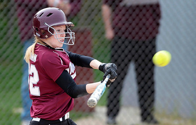 Kyle Grillot - kgrillot@shawmedia.com   Prairie Ridge junior Claire Bowman swings for the ball during the girls softball game at Prairie Ridge high school Monday, May 12, 2013.