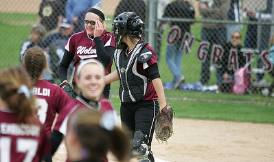 Kyle Grillot - kgrillot@shawmedia.com   Prairie Ridge senior Kirsten Stevens celebrates with her team after winning the girls softball game against Cary-Grove on Monday, May 12, 2013.