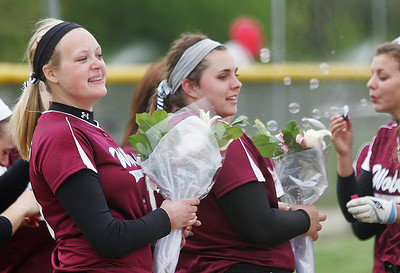 Kyle Grillot - kgrillot@shawmedia.com   Prairie Ridge seniors Kirsten Stevens and Marissa Richter celebrate after winning the girls softball game against Cary-Grove on Monday, May 12, 2013.