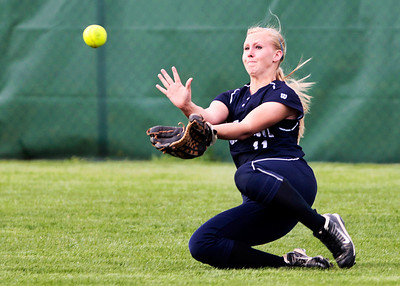 Kyle Grillot - kgrillot@shawmedia.com   Cary-Groove junior Lisa Semro slides to make a catch during the girls softball game at Prairie Ridge high school Monday, May 12, 2013.