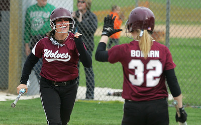 Kyle Grillot - kgrillot@shawmedia.com   After scoring the final point of the game, Prairie Ridge junior Rachel Crimaldi celebrates with  junior Claire Bowman during the girls softball game against Cary-Grove Monday, May 12, 2013.