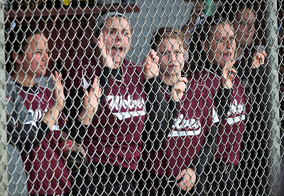 Kyle Grillot - kgrillot@shawmedia.com   Prairie Ridge senior Marissa Richter (second from left) cheers on her teammates during the girls softball game at Prairie Ridge high school Monday, May 12, 2013.