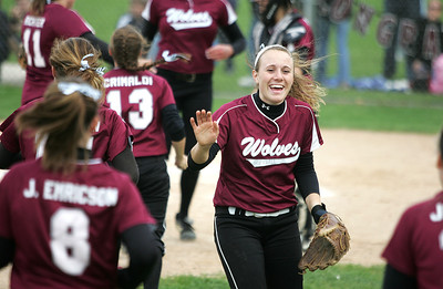 Kyle Grillot - kgrillot@shawmedia.com   Prairie Ridge junior Sammy Hempen celebrates with her team after beating Cary-Grove in the girls softball game at Prairie Ridge high school Monday, May 12, 2013.