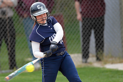 Kyle Grillot - kgrillot@shawmedia.com   Cary-Grove senior Sarah Luedo swings for the ball during the girls softball game at Prairie Ridge high school Monday, May 12, 2013.