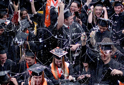 Sarah Nader - snader@shawmedia.com The class of 2013 celebrates with silly string during  McHenry East High School's Commencement on Wednesday, May 15, 2013.