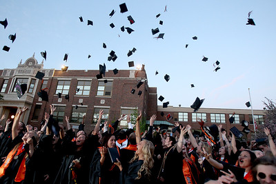 Sarah Nader - snader@shawmedia.com The class of 2013 throw their caps in the air after McHenry East High School's Commencement on Wednesday, May 15, 2013.