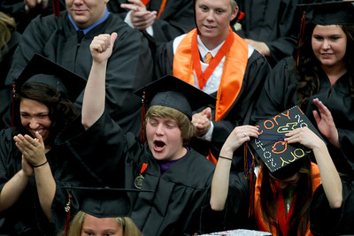 Sarah Nader - snader@shawmedia.com Steven Freund (center)  celebrates during McHenry East High School's Commencement on Wednesday, May 15, 2013.