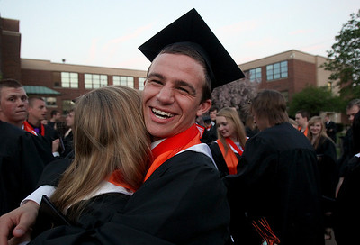 Sarah Nader - snader@shawmedia.com John Konstantelos hugs a friend after McHenry East High School's Commencement on Wednesday, May 15, 2013.