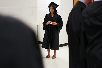 Sarah Nader - snader@shawmedia.com Arely Morales, 19, of McHenry waits in line before McHenry West High School's Commencement on Wednesday, May 15, 2013. Morales plans to study nursing at McHenry County College next year.