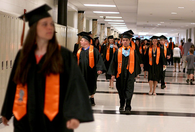 Sarah Nader - snader@shawmedia.com Students walk down the hall during McHenry West High School's Commencement on Wednesday, May 15, 2013.