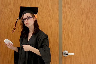 Sarah Nader - snader@shawmedia.com Kaitlynn Mueller, 17, of McHenry waits in line before  McHenry West High School's Commencement on Wednesday, May 15, 2013. Mueller plans to study social work at McHenry County College next year.