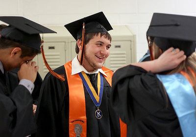 Sarah Nader - snader@shawmedia.com Derek Macek, 18, of McHenry laughs with friends before  McHenry West High School's Commencement on Wednesday, May 15, 2013. Macek plans to study civil engineering at the University of Illinois at Chicago after graduation.