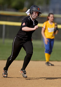 Sarah Nader - snader@shawmedia.com Crystal Lake Central's Megan Mahaffy runs towards third after hitting a home run during the first inning of Thursday's game against Johnsburgl in Crystal Lake on May 16, 2013. Crystal Lake Central won, 8-0.