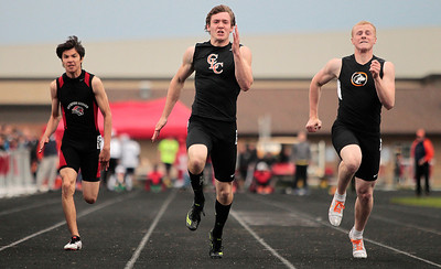 Kyle Grillot - kgrillot@shawmedia.com   Crystal Lake Central senior Isaiah Mosher (center) competes in the finals 100-meter dash event during the class 3A sectional at Huntley high school Friday, May 17, 2013.