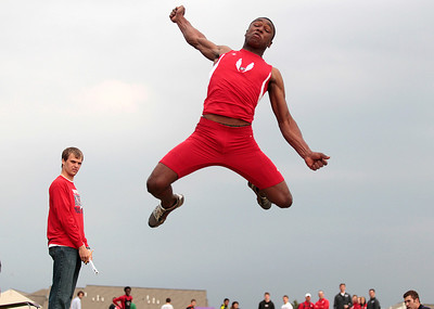 Kyle Grillot - kgrillot@shawmedia.com   Grant high school junior Jonathan Wells competes in the long jump event during the class 3A sectional at Huntley high school Friday, May 17, 2013.