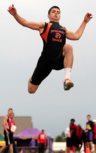 Kyle Grillot - kgrillot@shawmedia.com  McHenry senior Korey Partenheimer competes in the long jump event during the class 3A sectional at Huntley high school Friday, May 17, 2013.