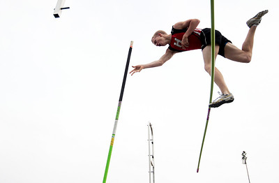 Kyle Grillot - kgrillot@shawmedia.com   Huntley senior Craig Lambert competes in the boys pole vault event during the class 3A sectional at Huntley high school Friday, May 17, 2013.
