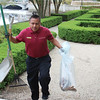 Maintenance worker Manuel Navarro cleans up the gardens at Hotel Baker Thursday.
