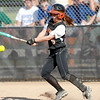 St. Charles East's Lexi Perez makes contact with the ball during their home game against St. Charles North Tuesday.