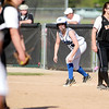 Amanda James of St. Charles North gets ready to take off at first base during their game at St. Charles East Tuesday.