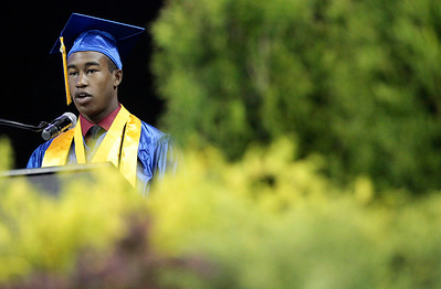 Kyle Grillot - kgrillot@shawmedia.com   Salutatorian Malik Washington gives a speech at the start of the Thirtieth Annual Dundee-Crown Commencement Saturday at the Sears Centre.