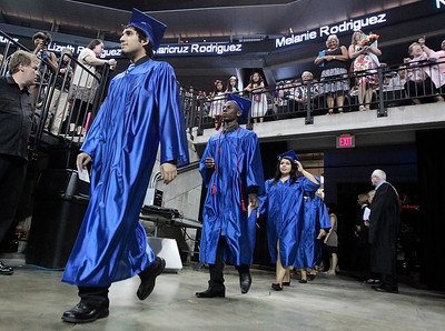 Kyle Grillot - kgrillot@shawmedia.com   Graduates enter the arena before the start of the Thirtieth Annual Dundee-Crown Commencement Saturday at the Sears Centre.