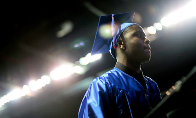 Kyle Grillot - kgrillot@shawmedia.com   Latrell Deshun Crenshaw waits to take the stage during the Thirtieth Annual Dundee-Crown Commencement Saturday at the Sears Centre.