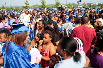 Kyle Grillot - kgrillot@shawmedia.com   Friends and family greet the graduates as they come out of the Sears Centre after the Thirtieth Annual Dundee-Crown Commencement Saturday.