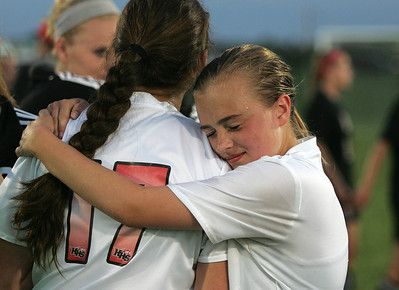 Kyle Grillot - kgrillot@shawmedia.com   huntley freshman Alyssa Kaufman (right) comforts senior Crystal Hoffman after losing to Barrington in the girls regional soccer game at Jacobs high school Tuesday.