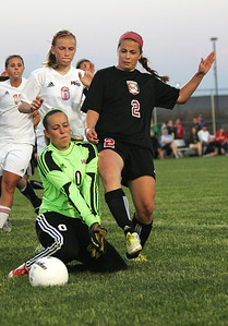 Kyle Grillot - kgrillot@shawmedia.com   Barrington senior Alexa Dargis kicks the ball past Huntley sophomore goalie Kelli Rubinoduring the second half of the girls regional soccer game at Jacobs high school Tuesday.