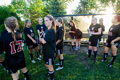 Kyle Grillot - kgrillot@shawmedia.com   Barrington soccer players gather around the bench during the half time of the girls regional soccer game at Jacobs high school Tuesday.