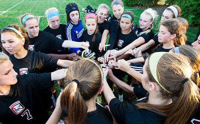 Kyle Grillot - kgrillot@shawmedia.com   Barrington soccer players huddle together during the half time of the girls regional soccer game at Jacobs high school Tuesday.