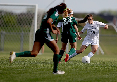 Sarah Nader - snader@shawmedia.com Cary-Grove's Ellie Prim brings the ball down field during the second half of Tuesday's Regional game against Rockford Boylan in Algonquin on May 21, 2013. Cary-Grove lost, 3-0.