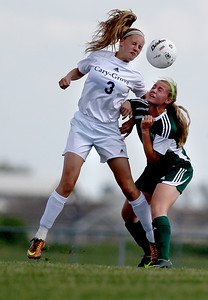 Sarah Nader - snader@shawmedia.com Cary-Grove's Candace Cunningham (left) and Boylan's Emma Krahmer head the ball during the first half of Tuesday's Regional game in Algonquin on May 21, 2013. Cary-Grove lost, 3-0.