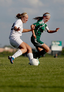 Sarah Nader - snader@shawmedia.com Cary-Grove's Brittany Loehner (left) is guarded by Boylan's Leigha Crowder during the second half of Tuesday's Regional game in Algonquin on May 21, 2013. Cary-Grove lost, 3-0.
